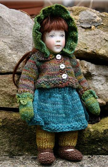 For any of the Little Friends, modeled here by Ivy. Here is a gorgeous completely hand knitted set, it is little Rowans design from last year but in a totally different colourway we are calling the Woodland set, it is made up of 8 different items knitted from yarns that are beautifully space dyed pure wool in shades of greens and browns.