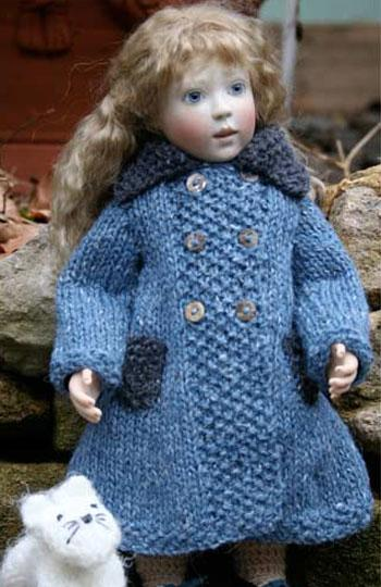 "For any of our small, 10"" - 11 1/2"" wood bodied dolls. Modeled here by Rose.   Here we have a lovely little liberty lawn dress in shades of blue, over this there is a really gorgeous hand knitted coat in two shades of tweedy blue wool. Also included in this set is a pair of leather and ultra suede shoes and the little white kitty."
