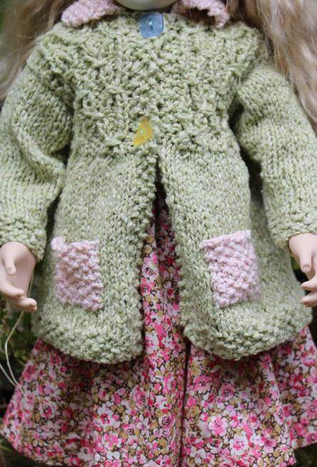 Lovely detail of the hand knitted coat and cotton print skirt.