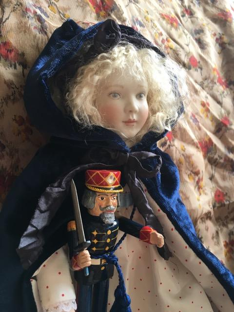 """Pippa as Clara from The Nutcracker. She is 12"""" tall with a cloth body. She comes with a wonderful Nutcracker doll by Eric Horne. This special edition is now sold out."""